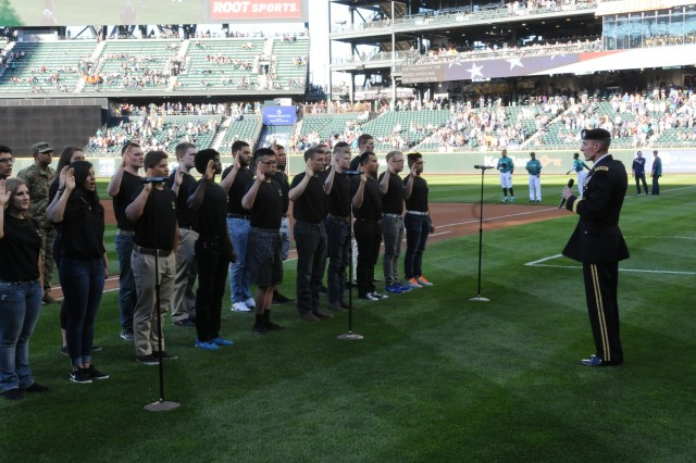 )  I Corps commander,Lt. General Gary J. Volesky, gives the oath of enlistment to Future Soldiers before a Mariner's game June 23, 2017 at Safeco Field. The Future Soldiers received a standing ovation from Mariner's fans. (U.S. Army photo by Pvt. Ethan Valetski)