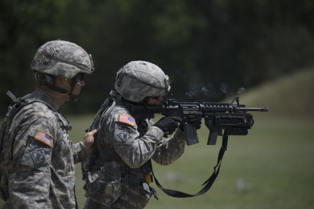 A smoking case from a 5.56mm round flies out of an M4 during reflexive fire training at Fort McCoy, Wisconsin, June 23. The training was part of Guardian Justice, a functional exercise, broken down into two-week cycles, centered on squad and team-level training with a focus on internment, resettlement, detainee operations and combat support. During each two-week cycle, Soldiers train on internment operations, weapons qualification, biometrics, reflexive fire, Military Operations on Urbanized Terrain (MOUT), non-lethal Tasers, MP battle drills and situational training exercises.