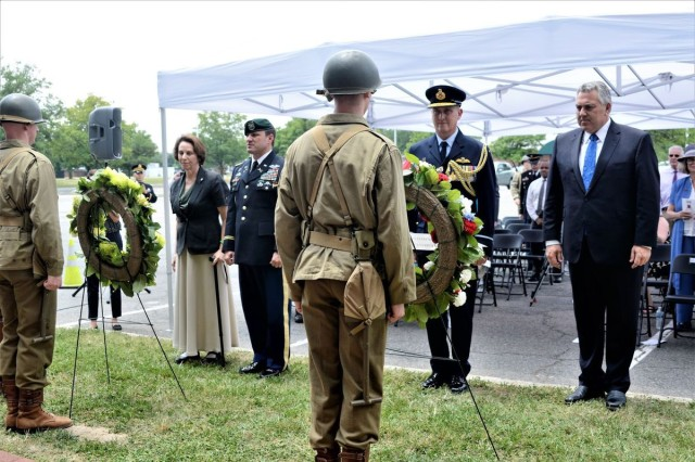 From left to right -- Arlington County Board member Libby Garve3y, Joint Base Myer-Henderson Hall Commander Col. Patrick M. Duggan, Australian Air Commodore Gary Martin and Australian Ambassador to the United States Joe Hockey place a pair of wreaths at the Bakers Creek Memorial near Selfridge Gate on Joint Base Myer-Henderson Hall June 14. A ceremony commemorating the Bakers Creek air disaster honored 40 American service members who were killed in Australia 74 years ago during World War II.
