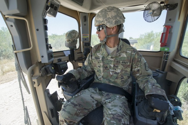 Sgt. Vincent Seman, assigned to the 277th Engineer Company based in San Antonio, prepares to use a road grader while repairing a 2.5-mile stretch of dirt road in a colonia near Laredo, Texas, as part of an Innovative Readiness Training mission June 23, 2017. Seman and nearly 200 Reserve Soldiers are participating in the mission along the Texas-Mexico border.