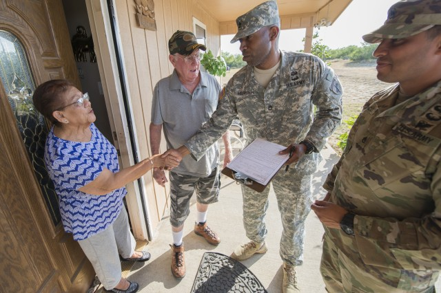 Sgt. 1st Class Rhody Merisier, middle right, and Staff Sgt. Aldo Blanco, both assigned to the 478th Civil Affairs Battalion based in Miami, conduct a survey with residents of a colonia currently without potable water near Laredo, Texas, June 23, 2017. Nearly 200 Reserve Soldiers are participating in an Innovative Readiness Training mission to improve infrastructures in colonias along the Texas-Mexico border.