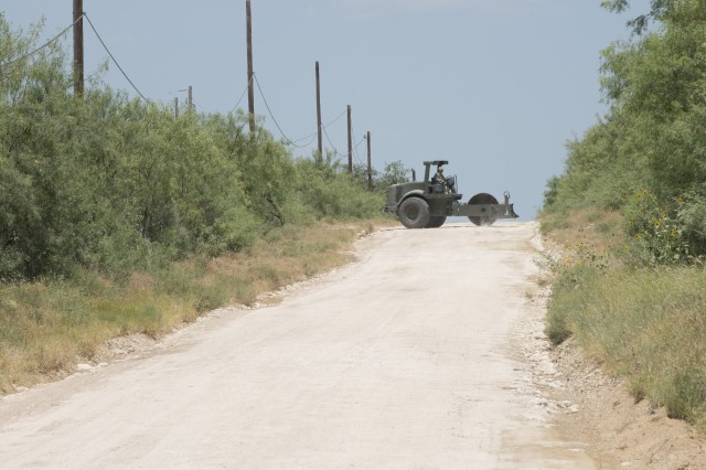 Soldiers with the 277th Engineer Company based in San Antonio repair a 2.5-mile stretch of dirt road in a colonia near Laredo, Texas, as part of an Innovative Readiness Training mission June 23, 2017. Nearly 200 Reserve Soldiers are participating in the mission along the Texas-Mexico border.