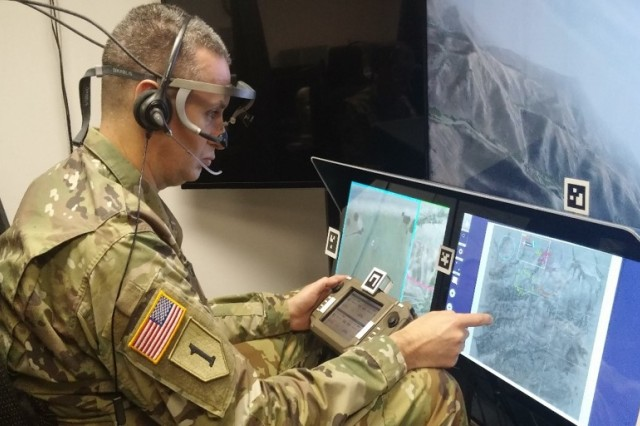 Col. Steven Braddom, Director of the Aviation Applied Technology Directorate, evaluates the SCORCH system, which manages multiple unmanned aerial systems simultaneously.