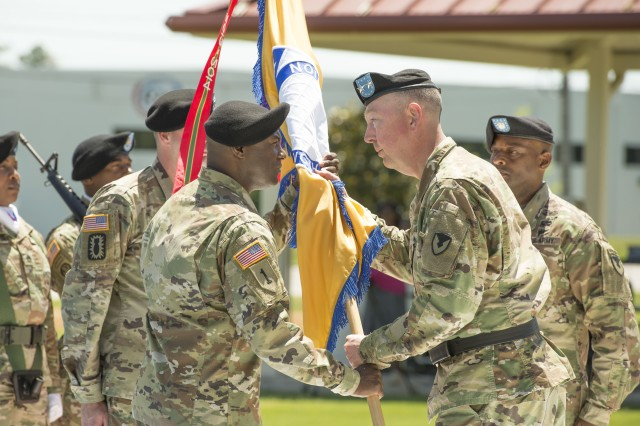 USASAC's new command sergeant major Gene Canada accepts the command flag from Maj. Gen. Stephen Farmen, USASAC commanding general, as outgoing Command Sgt. Maj. Dana Mason, right, looks on during a change of responsibility ceremony held June 27 on AMC's Parade Field on Redstone Arsenal, Alabama.