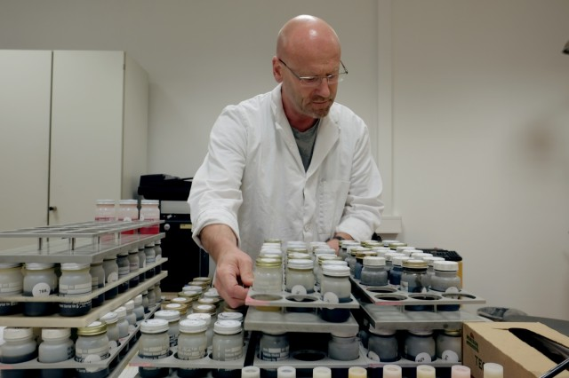 Detlef Nuss, a physical science technician at the Army Oil Analysis Program lab in Kaiserslautern, examines some recently arrived oil samples, Friday June, 23 2017 at the AOAP lab on Kaiserslautern Army Depot in Germany.
