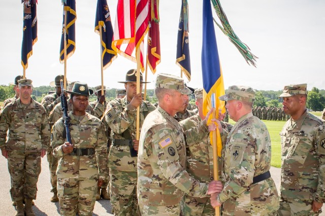 Col. Sean Crockett, left, receives the 3rd Chemical Brigade flag from Brig. Gen. James Bonner, U.S. Army Chemical, Biological, Radiological and Nuclear School commandant, signifying Crockett's accepting the position of brigade commander in a ceremony Friday on Gammon Field.