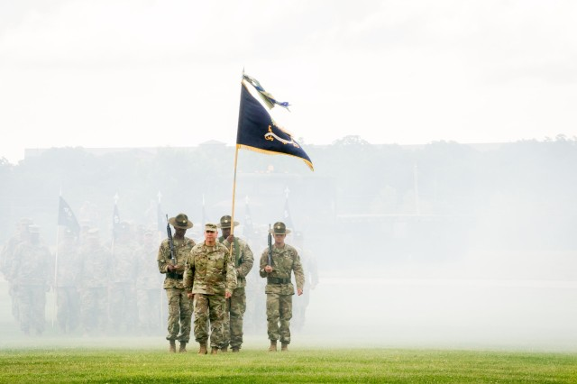 Lt. Col. Christopher Judge leads the 1st Battalion, 48th Infantry Regiment color guard onto the field at the beginning of the brigade Change of Command Ceremony Friday on Gammon Field.