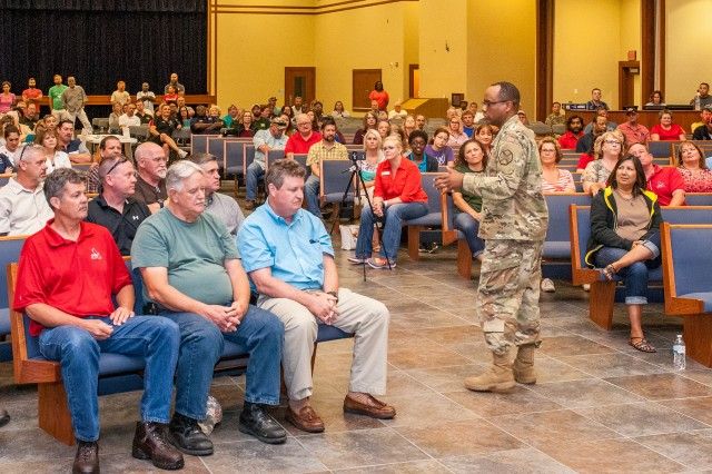Col. Tracy Lanier, U.S. Army Garrison Fort Leonard Wood commander, addresses garrison employees about the IMCOM Service Culture Initiative.