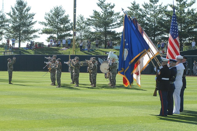 The Fort Leonard Wood Joint Services Color Guard presents the colors as the 399th Army Band plays the national anthem Saturday during Military Appreciation Day pre-game activities at Hammons Field in Springfield, Mo.