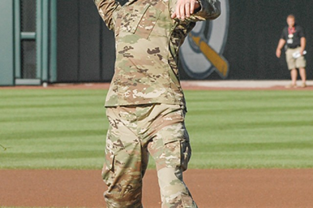 Fort Leonard Wood's Noncommissioned Officer of the Year, Staff Sgt. Ryan McCarthy, throws out a ceremonial pitch Saturday at Hammons Field in Springfield, Mo.