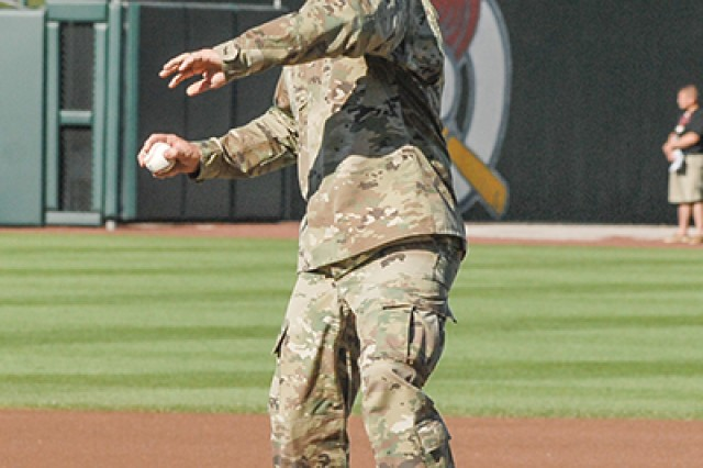 Maj. Gen. Kent Savre, MSCoE and Fort Leonard Wood commanding general, throws out a ceremonial pitch Saturday during Military Appreciation Day pre-game ceremonies at Hammons Field.