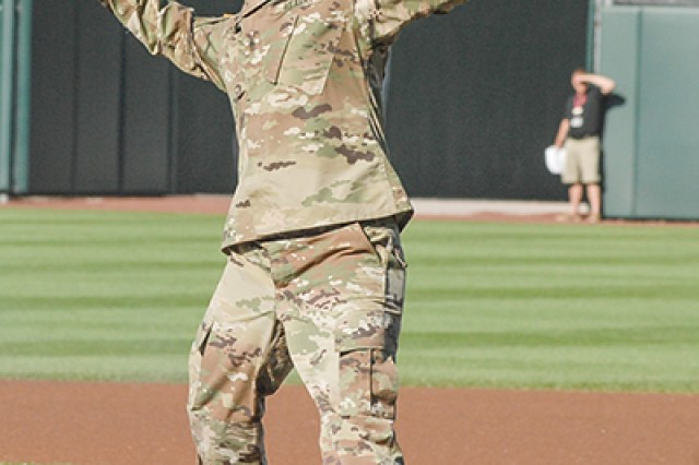 Command Sgt. Maj. Jon Stanley, MSCoE and Fort Leonard Wood command sergeant major, throws out a ceremonial pitch Saturday as part of Military Appreciation Day.