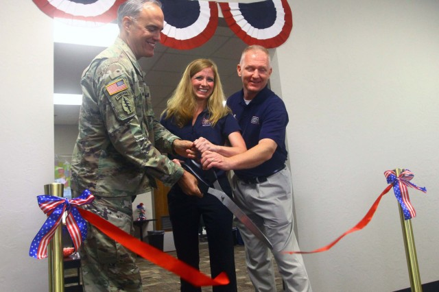 Fort Sill Garrison Commander Col. Samuel Curtis, USO Center Director Jennifer Kirby, and David Rollins, USO Transition Services site manager, cut the ribbon June 20, 2017, to to officially open the services office located in the Soldier for Life Transition Complex at Fort Sill, Okla. Transition Services had a soft opening in November, and has served more than 200 clients. It works with the SFL and numerous other agencies and companies to assist transitioning service members, Guard and Reserve members, family members and veterans in eight major service categories.