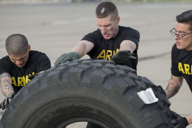 Sgt. Maj. of the Army Daniel Dailey, center, flips a giant truck tire with two 916th Support Brigade Soldiers during a strenuous physical training session at Fort Irwin, Calif., June 8, 2017. Dailey, who has stressed the importance of PT to ensure Soldiers are ready to fight, can often be seen exercising with Soldiers while on installation visits.