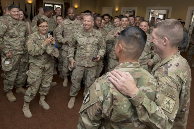 Soldiers wait to have their photo taken with Sgt. Maj. of the Army Daniel Dailey, right, after a town hall at Fort Irwin, Calif., June 8, 2017. Dailey, who has an outgoing and approachable personality, makes it a priority to meet with Soldiers and hear their concerns wherever he goes.