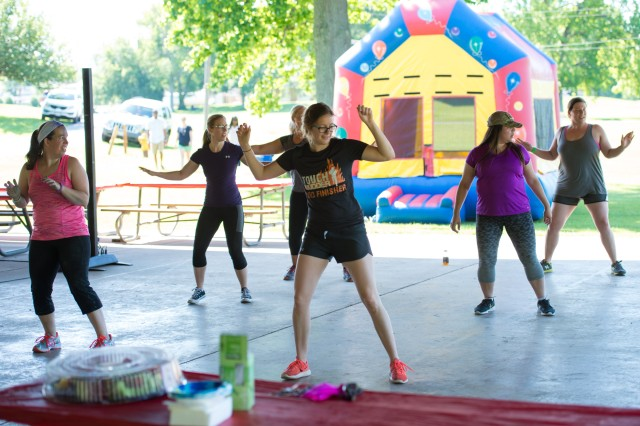 Attendees at the Army Public Health Center's Organization Day participate in Zumba at the CAPA Field pavilion on June 9.