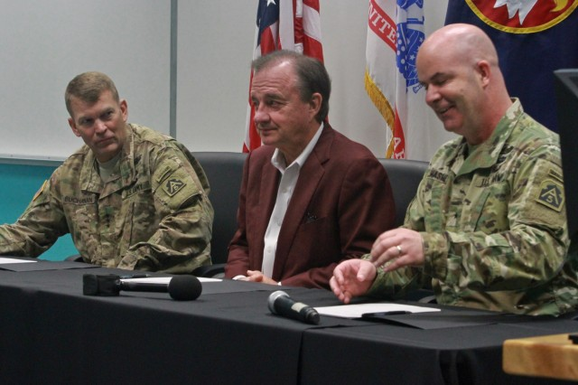 "(far left) Lt. Gen. Jeffrey S. Buchanan, commander of U.S. Army North (Fifth Army) at Joint Base San Antonio-Fort Sam Houston, John Sharp, chancellor of Texas A&M University System, and Brig. Gen. John Hashem, deputy commanding general - support and director of Army North's Army Reserve Engagement Cell (AREC), prepare to sign the Memorandum of Understanding at Laredo Community College's De La Garza building in Laredo, Texas, June 27 during the Innovative Readiness Training (IRT) Mission. This memorandum signifies the commitment of the military and the surrounding communities in future IRT missions. ""It's our [the military] purpose to protect the American people, and that's what signing this document means,"" said Buchanan. (Photo by Staff Sgt. Tomora Nance, U.S. Army North Public Affairs)"