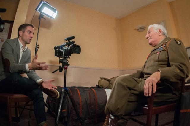 Staff Sgt. Adam Harder is talking to Vince Speranza in December 2015, in Bastogne.