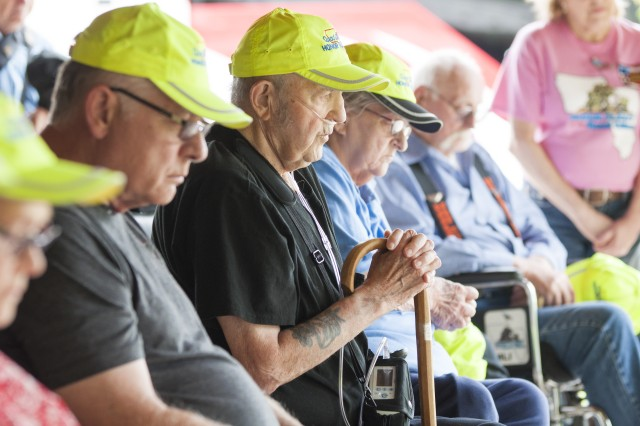 Military veterans have a moment of silence for the fallen during an Honor Tour at the Rock Island National Cemetery, Rock Island Arsenal, Illinois, June 29.