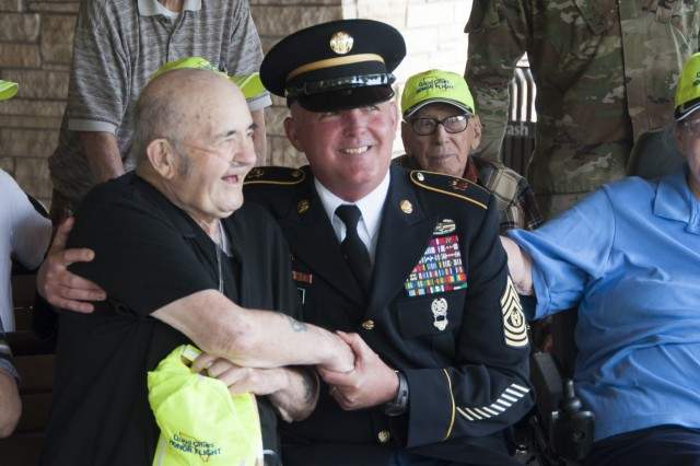Command Sgt. Maj. Richard K. Johnson, command sergeant major, First Army, meets with a veteran during an Honor Tour at the Rock Island National Cemetery, Rock Island Arsenal, Illinois, June 29.