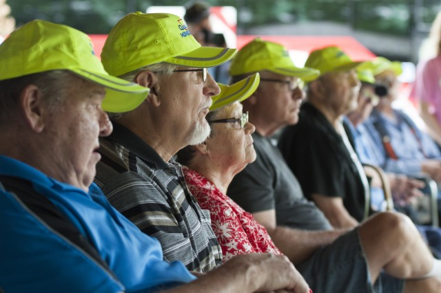 Military veterans listen to a speech given by Command Sgt. Maj. Richard K. Johnson, command sergeant major, First Army, during an Honor Tour at the Rock Island National Cemetery, Rock Island Arsenal, Illinois, June 29.