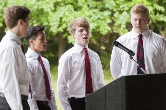 Students from Bettendorf High School in Bettendorf, Iowa, sing the national anthem during an Honor Tour at the Rock Island National Cemetery, Rock Island Arsenal, Illinois, June 29.