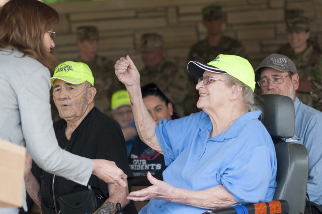 Betty Felder, a former military nurse from Silvis, Illinois, receives a Vietnam War veteran pin during an Honor Tour at the Rock Island National Cemetery, Rock Island Arsenal, Illinois, June 29.
