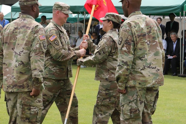 Maj. Sara Cardenas of Chicago, Ill. (right), outgoing commander, 14th Missile Defense Battery, receives the unit's guidon from the outgoing first sergeant, 1st Sgt. Benjamin Sharp of Colorado Springs, Colo., during the 14th MDB change of command and responsibility ceremony held Monday, June 26, 2017, in the Centrale Hotel at Omiya, Kyotango, Japan. The passing of the unit's guidon represents the transfer of command and responsibility from one individual to the other. This ceremony represented the complete transfer of responsibility, authority and accountability from the outgoing command team to Capt. Anton McDuffie of Tampa, Fla., the incoming commander and 1st. Sgt. Myron Metcalf of Fayetteville, N.C., the incoming first sergeant.