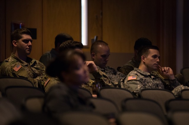U.S. Army dentists listen to presenters during the Puget Sound Dental Symposium June 12 and 13 at Madigan Army Medical Center. Attendees of the Puget Sound Dental Symposium could earn up to 15 continuing dental education hours for attending all lectures, including the presentations by eight residents from the Advanced Education in General Dentistry 12-Month Program (AEGD 12-MP) at JBLM (U.S. Army photo by Ryan Graham, Madigan Army Medical Center).