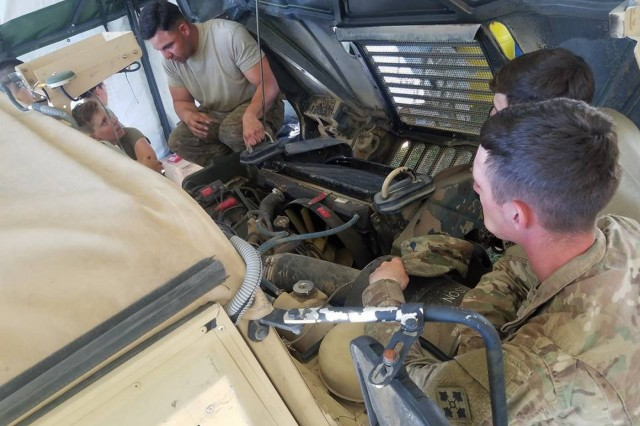 Soldiers of 64th Brigade Support Battalion, 3rd Armored Brigade Combat Team, 4th Infantry Division, conduct preventative maintenance checks and services on a Humvee while preparing for the U.S. Army Europe-led Getica Saber 17 multinational exercise at the Cincu Joint Multinational Training Center in Cincu, Romania, June 30, 2017. Getica Saber is a U.S.-led fire coordination exercise and combined-arms live fire exercise being held from July 8-15 to highlight participant deterrence capabilities, specifically the ability to mass forces at any given time anywhere in Europe. Besides the 3rd ABCT, 4th Inf. Div., Getica Saber will feature the Romanian 282nd Mechanized Brigade, the U.S. 1st Cavalry Division Artillery and service members from Croatia, Ukraine, Portugal, Montenegro and Armenia. (U.S. Army photo by Staff Sgt. Ange Desinor, 3rd Armored Brigade Combat Team, 4th Infantry Division)