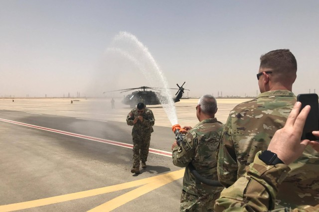 Col. Ray Herrera, center, gets hosed down from his staff after taking his last flight in Saudi Arabia before departing for his next assignment at Fort Sam Houston.