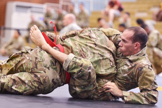 Staff Sgt. Timothy Hernandez, 501st Military Intelligence Brigade, works to escape a hold during his match in the Eighth Army Combatives tournament June 30 at U.S. Army Garrison Yongsan's Collier Community Fitness Center.