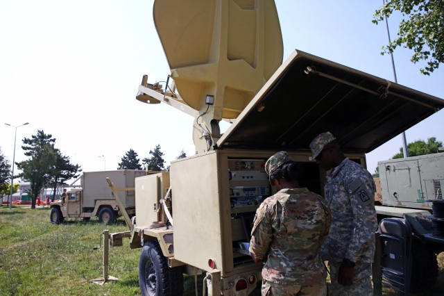 U.S. Army Spc. Kendra Smith and Spc. Antwan Campbell, both assigned to Charlie Company, 86th Expeditionary Signal Battalion, 11th Signal Brigade, work to establish a satellite link June 29, 2017 at Mihail Kogalniceanu Air Base, Romania. The 86th Expeditionary Signal Bn. from Fort Bliss, Texas is augmenting 2nd Theater Signal Brigade with additional tactical signal assets and capability for exercise Saber Guardian 17, a U.S. Army Europe-led, multinational exercise, taking place in Bulgaria, Hungary and Romania July 11-20, 2017.