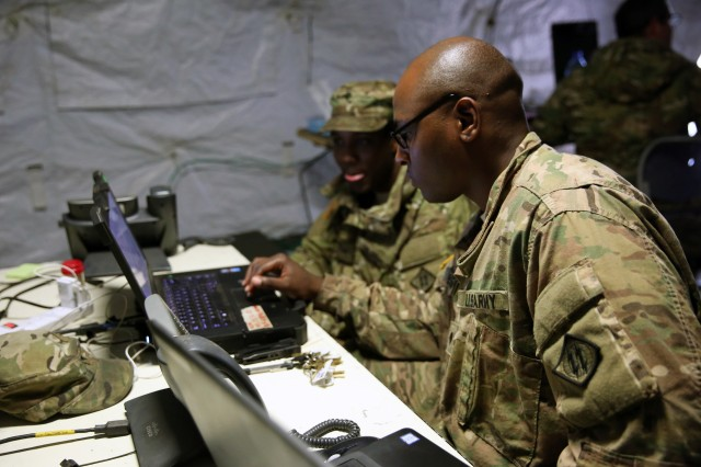 U.S. Army Spc. Justin Pelzer, a Command Post Node operator assigned to Charlie Company, 44th Expeditionary Signal Battalion, 2nd Theater Signal Brigade, and Spc. Isaiah Myles, the CPN team chief, check the status of the network July 3, 2017 in Cincu, Romania. Myles' CPN team is providing communications support to the 497th Combat Sustainment Support Battalion, 55th Sustainment Brigade, a U.S. Army Reserve unit, during exercise Saber Guardian 17, a U.S. Army Europe-led, multinational exercise, taking place in Bulgaria, Hungary and Romania July 11-20, 2017.