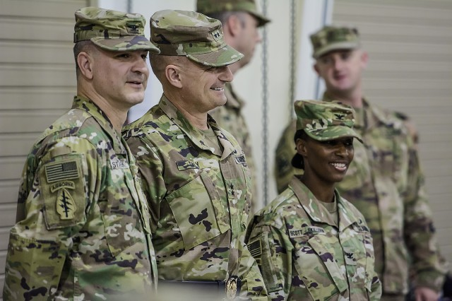 Left to right: Col. Aaron Stanek, outgoing commander, 401st Army Field Support Brigade, Maj. Gen. Edward Daly, commanding general, U.S. Army Sustainment Command, and Col. Carmelia Scott-Skillern, incoming commander, 401st AFSB, await the start of a change of command ceremony for the 401st AFSB at Camp Arifjan, Kuwait, June 30. (U.S. Army Photo by Justin Graff, 401st AFSB Public Affairs)