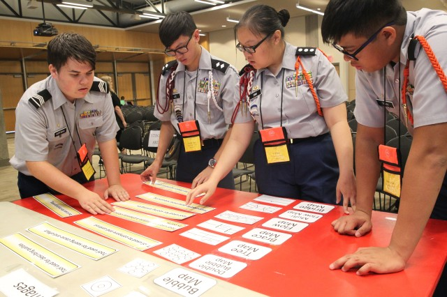 "Cadets (from left) Rex Hoffman, Joseph Lee, Vi Dihn, and Jaden Tran, from Stafford High School, Stafford, Texas, complete the Thinking Map Match challenge June 24. This was one of 10 stations Cadets competed at during the Army Leadership ""Gauntlet"" of the JROTC Leadership and Academic Bowl held at the Catholic University of the Americas, Washington, D.C., June 24-26."