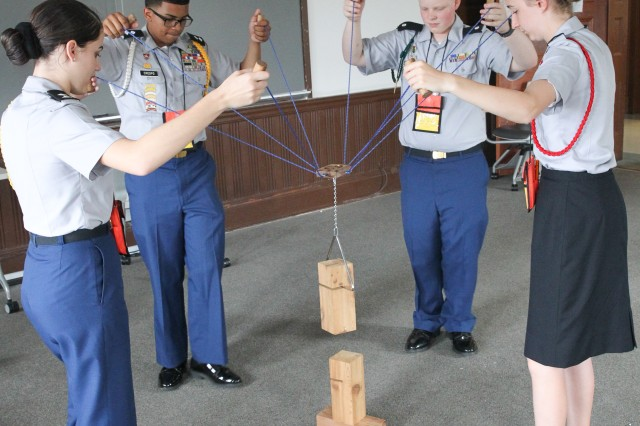 "JROTC Cadets from multiple schools use communication and teamwork to stack blocks as part of the ""How Tall the Tower?"" challenge during Leadership Reaction Course competition at the JROTC Leadership and Academic Bowl June 25. JLAB 2017 was held at the Catholic University of the Americas, Washington, D.C., June 24-26."