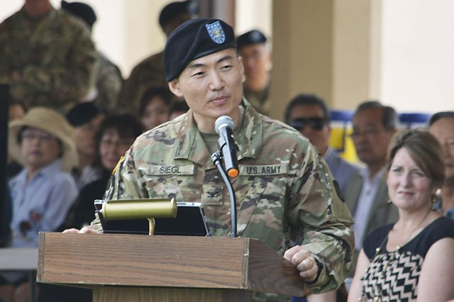 Col. Mike Siegl, outgoing commander, 403rd Army Field Support Brigade, speaks during the 403rd's change of command and responsibility ceremony June 28 at Camp Walker in Daegu, Republic of Korea.