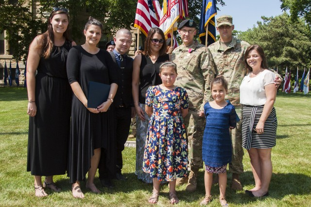 Col. Doyle Lassitter, commander, Distribution Management Center, U.S. Army Sustainment Command, and his family attend the DMC relinquishment of command and retirement ceremony on June 9 in Constitution Square, Rock Island Arsenal, Illinois.