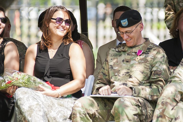 Col. Doyle Lassitter, commander, Distribution Management Center, U.S. Army Sustainment Command, laughs at a joke during the DMC relinquishment of command and retirement ceremony on June 9 in Constitution Square, Rock Island Arsenal, Illinois.