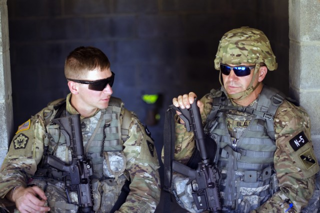 Staff Sgt. Jonathan Anderson (left), a Combat Engineer representing the 83rd U.S. Army Reserve Readiness Center, and Sgt. David Blalock a Cable Systems Installer-Maintainer representing the 75th Training Command, share a brief moment in the shade during Combat Skills Testing Lanes at the 2017 U.S. Army Reserve Best Warrior Competition at Fort Bragg, N.C. June 14. This year's Best Warrior Competition will determine the top noncommissioned officer and junior enlisted Soldier who will represent the U.S. Army Reserve in the Department of the Army Best Warrior Competition later this year at Fort A.P. Hill, Va.