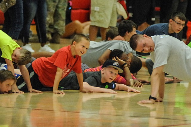 The event began with a stretching and warm-up session led by Jamal Verdell, Fort Leonard Wood Youth Sports director, and volunteers with the 364th Training Squadron, Air Force Det. 1.