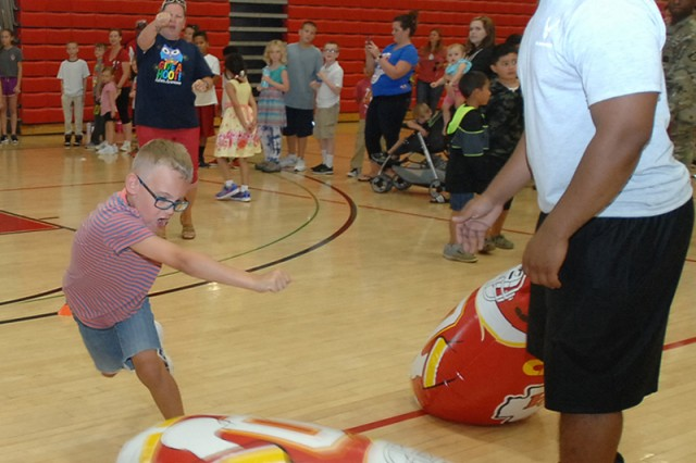 Sherman Stampfly, 7, punches an inflatable target to complete an agility drill during the NFL Play 60 event Friday.