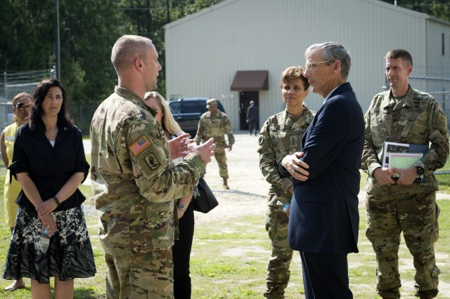 Sgt. 1st Class Richard Ciuk, left, noncommissioned officer in charge of the Fort Bragg Medical Simulation Training Center, briefs Acting Secretary of the Army Robert M. Speer about the facility's capabilities and mission, June 29.