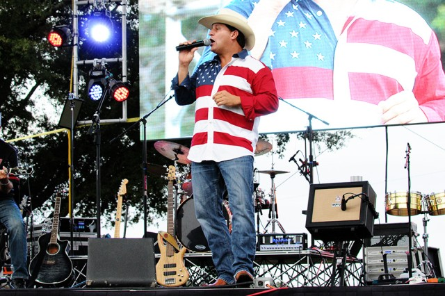 Shane Owens, country music star, performs a patriotic set during Freedom Fest at the festival fields.