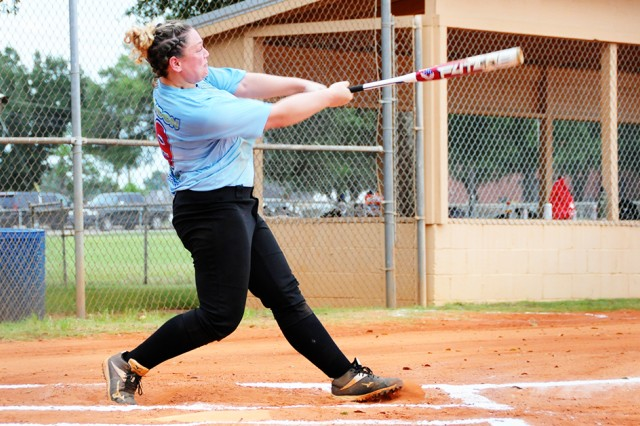Chelsey McLendon, player for Swift and Deadly, connects with the ball during a game at the Fort Rucker Softball Fields June 29.