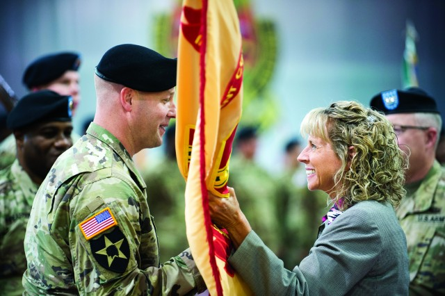 Col. Scott W. Mueller (left) took command of U.S. Army Garrison Humphreys on June 27 when he accepted the garrison colors from Installation Management Command Pacific Director Dr. Christine T. Altendorf (right).