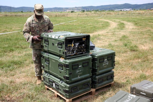 U.S. Army Sgt. Harrison Nichols, a Command Post Node team chief assigned to Alpha Company, 44th Expeditionary Signal Battalion, 2nd Theater Signal Brigade, sets up network stacks at his CPN site near Ramnicu Valcea, Romania, July 5, 2017. Nichols' CPN team will provide communications support to the 709th Military Police Battalion, 18th Military Police Brigade during exercise Saber Guardian 17,  a U.S. Army Europe-led, multinational exercise, taking place in Bulgaria, Hungary and Romania July 11-20, 2017.
