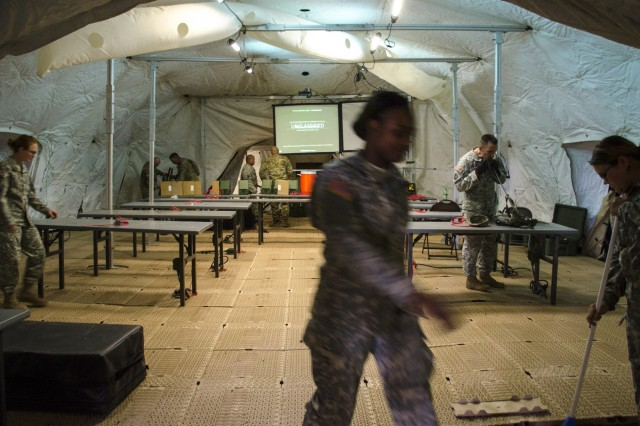 Soldiers with the 158th Maneuver Enhancement Brigade set up the interior of the tactical operations center tent during annual training at Camp Navajo, Ariz., June 3-17 in preparation of an upcoming Warfighter exercise later this year.