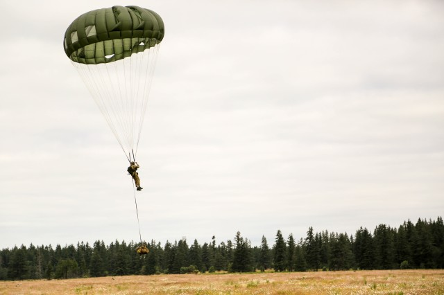"A Soldier in 1st Special Forces Group (Airborne) conducts airborne operations at Merrill Drop Zone, Joint Base Lewis-McChord, Wash. on June 27. 3rd Battalion, 1st SFG (A) conducted airborne operations during its ""Dragon Week"" exercise, testing readiness at the battalion level. (U.S. Army photo by Sgt. Wes Conroy)"